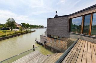 Einfamilienhaus kaufen in 7100 Neusiedl am See, Schickes Seehaus direkt am Wasser